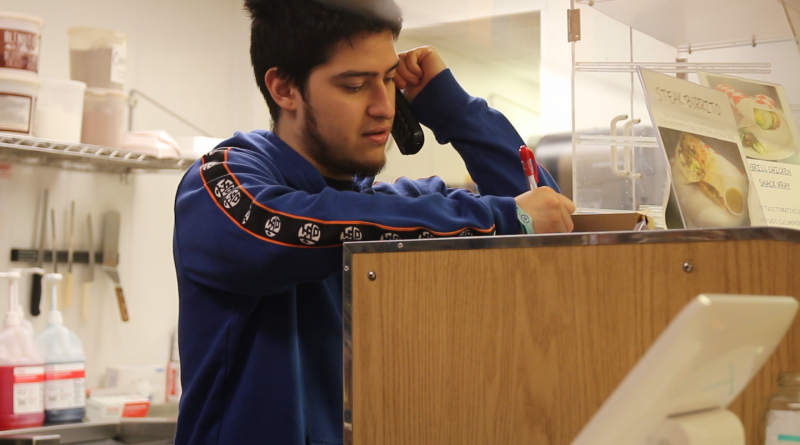 Rodrigo Orrala taking an order.